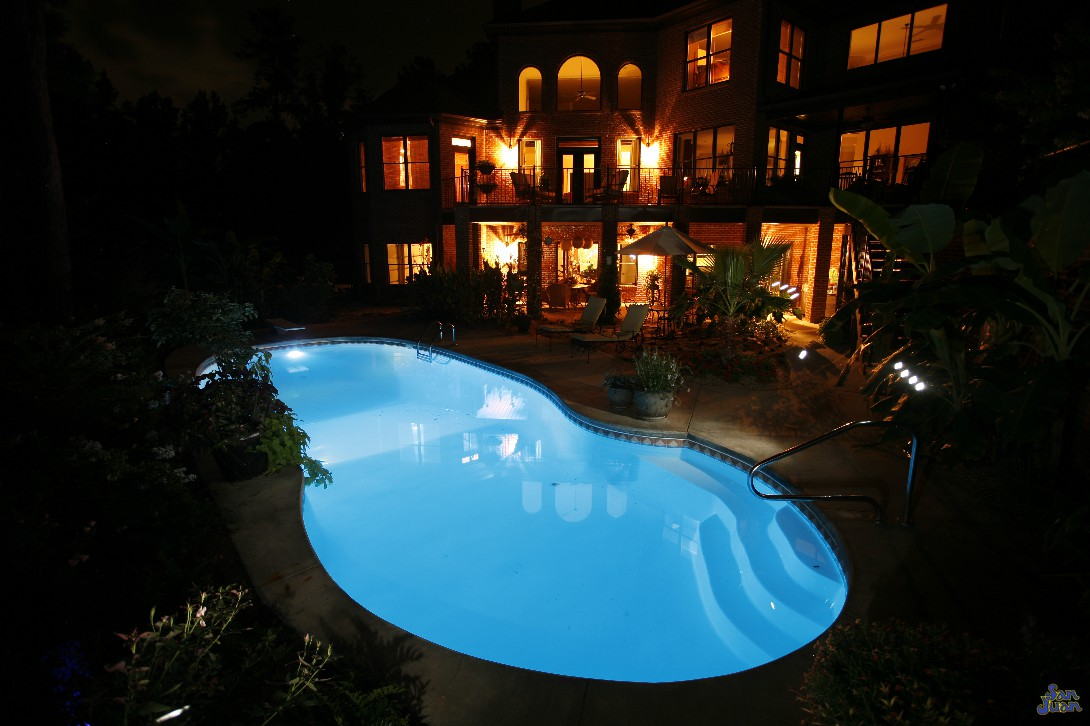 Outdoor fiberglass pools with LED Lighting at night for a beautiful look
