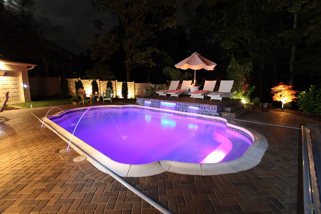 Professional photo of pool at night with led lights