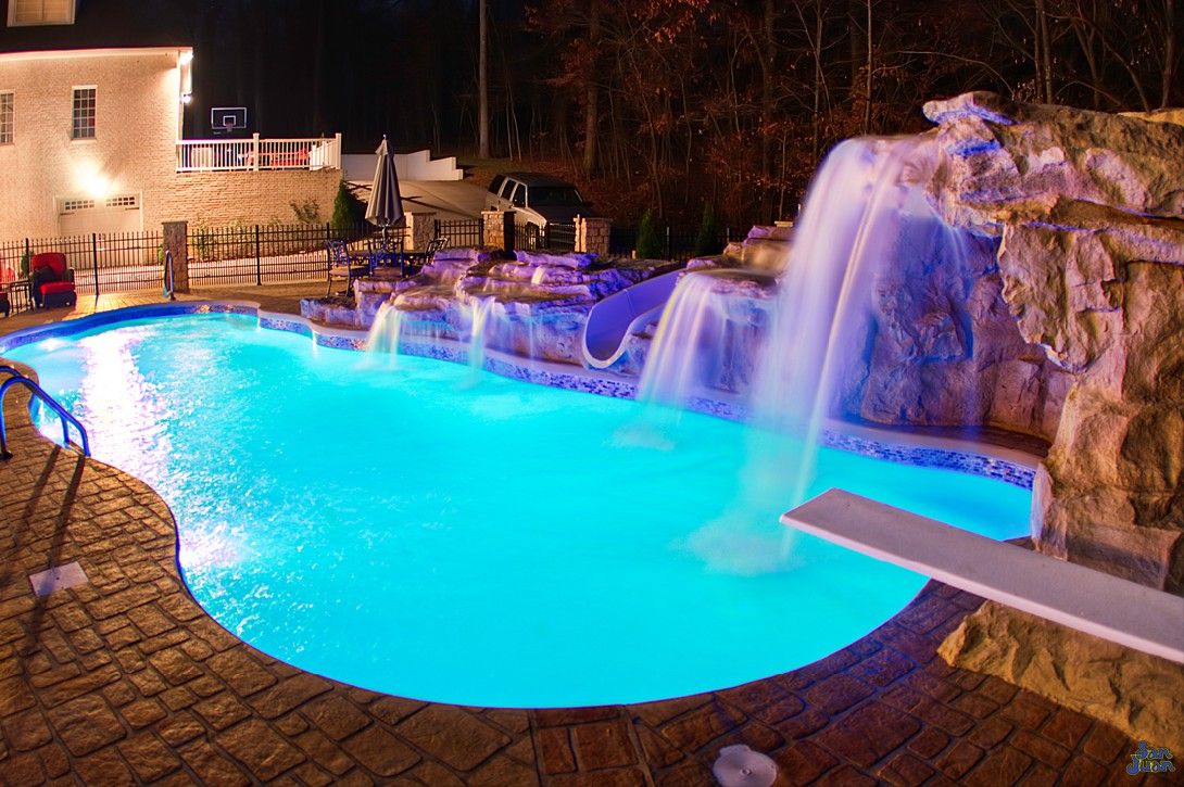 inground fiberglass pool with amazing water features