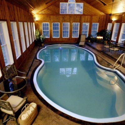 atlantic pool shape inside of indoor swimming pool cabin