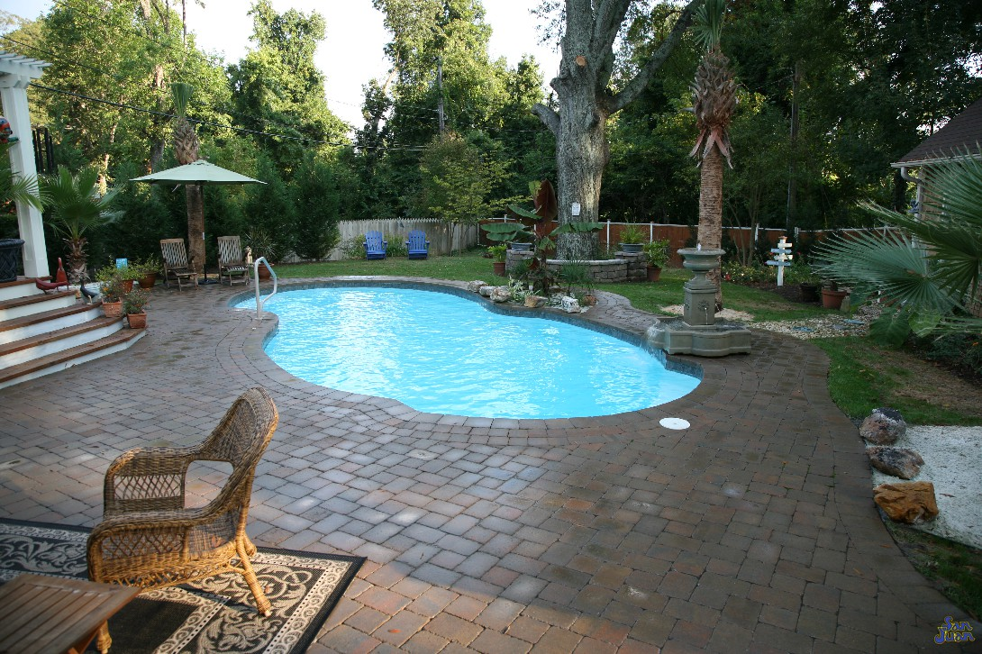 atlantic pool shape with brick pavers landscaping in. Black Bedroom Furniture Sets. Home Design Ideas