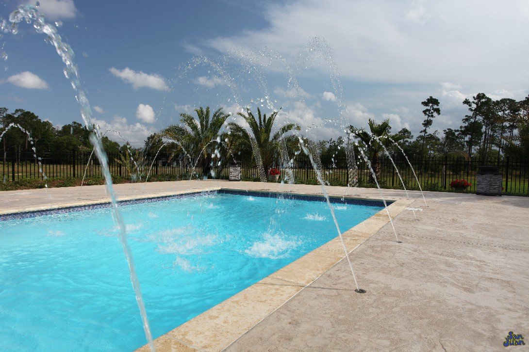 luxor deep fiberglass pool with raised tile wall and deck jets