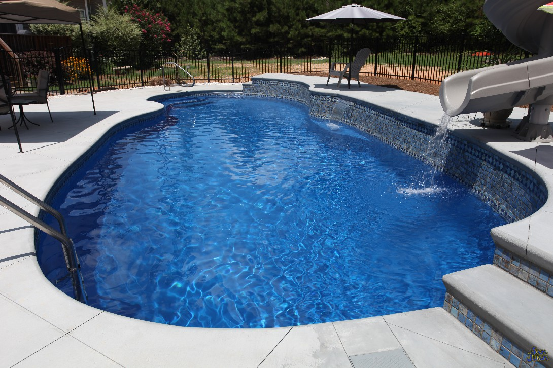 oasis fiberglass pool with deep end raised deck custom slide and raised tile wall (2)