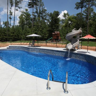 The Oasis Deep End Pool is a uniquely shape fiberglass shell with many contours and hidden attributes. Sporting a deep end design, curving architecture and shallow end steps - it's got some spice for that summer chili cook off!