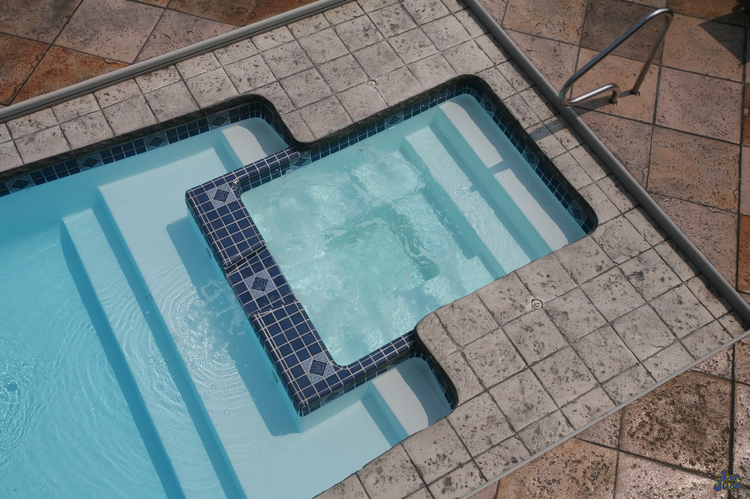 You can see the Olympus fiberglass pool outfitted with a tile liner across the rim of attached spa. There are many ways to spruce up this section of your fiberglass pool shell. We'll just leave the creativity up to you!