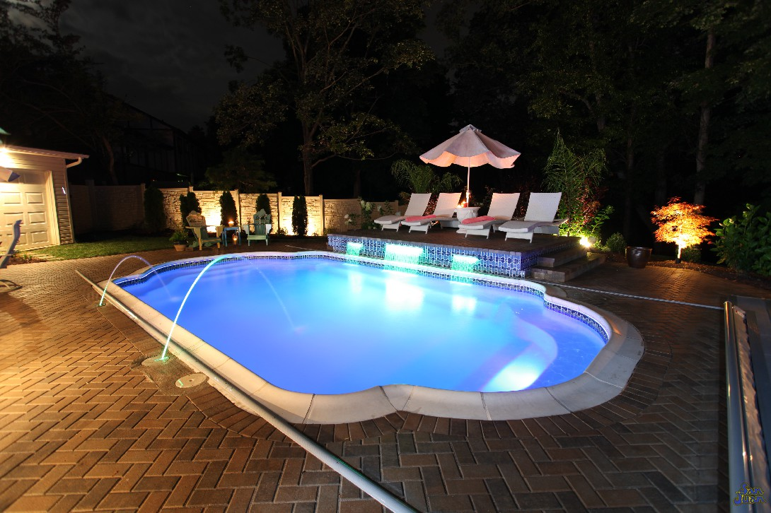 Whoa! What happened there? This pool looked purple above! Well, what you are seeing here is the magic of LED Lighting. Our fantastic pool lights have the capability of transforming your swimming pool into any color you can image. We even offer an automation package to control these fun lighting option from the palm of your hand. Use your smart phone or handheld remote and turn your backyard from an oasis into a party zone!