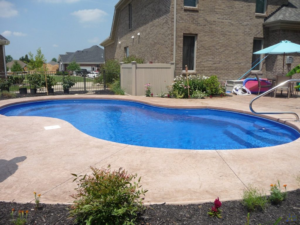 """The Venetian fiberglass pool has an overall length of 28' and a width of 14' 10"""". This gives us a maximum surface area of 311 SQFT. With a body of water that small, our gallon size is only 9,500 Gallons. This is a small pool capable of delivering exceptional energy savings. Not only are you saving on backyard space, but your wallet will thank you for a lower electric bill than a larger swimming pool."""