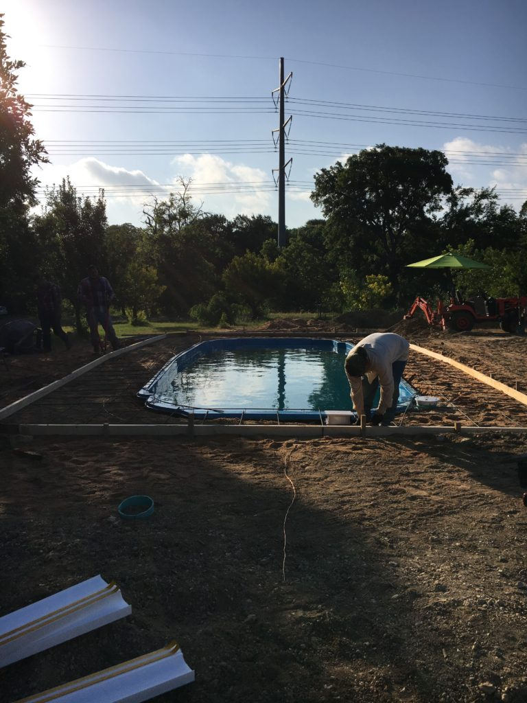 "To start up, what you are seeing here is the arrival of our concrete crew. They are currently prepping our fiberglass pool to have a concrete deck put in. They show up at the crack of dawn to lay the ""steel"" (rebar) in a 12""x12"" perimeter around our swimming pool. Once the steel is tied, they begin the process of pouring our concrete deck."