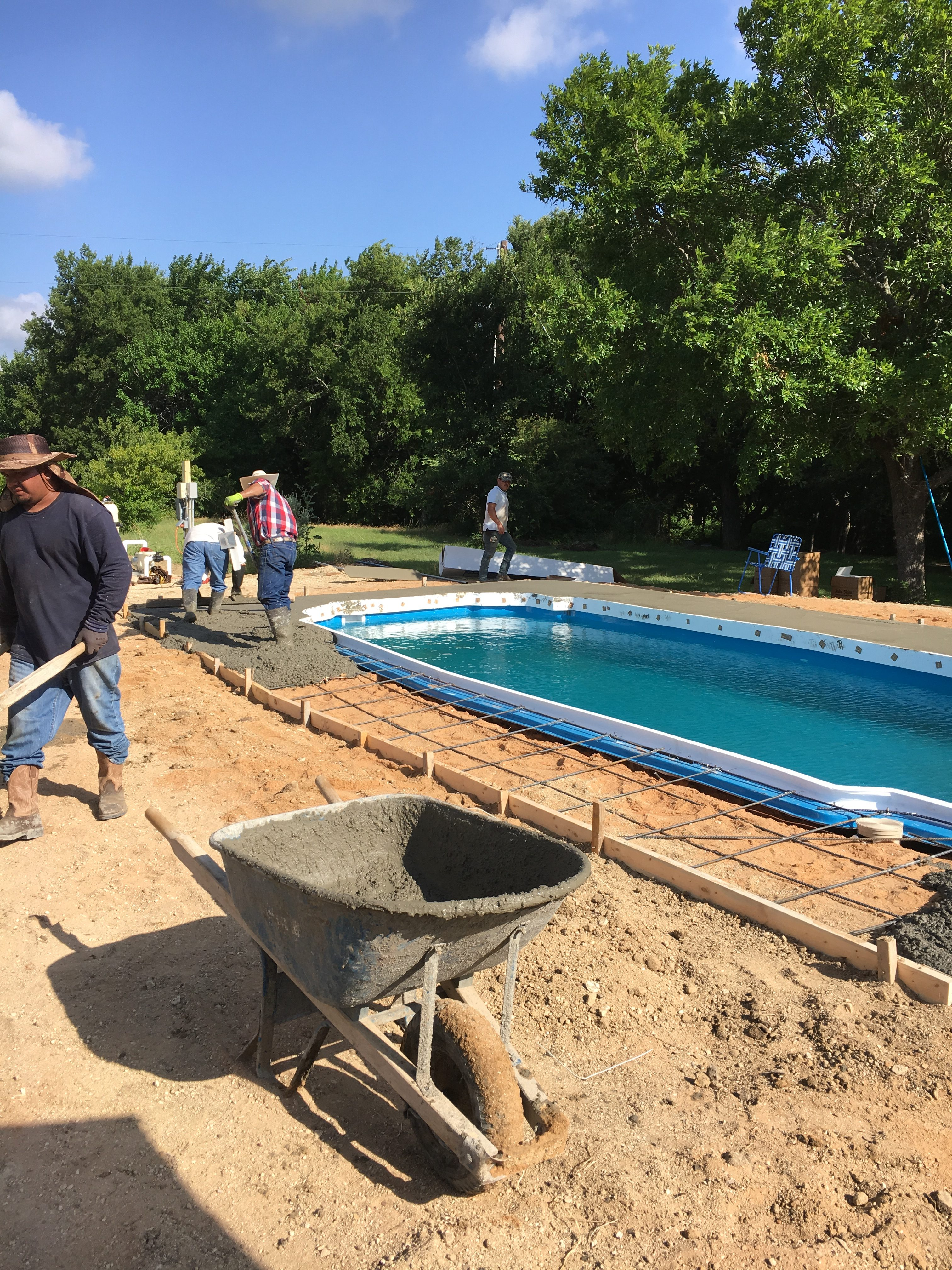 """Pouring a concrete pool deck is tough work. It's also messy work. That's why we always hire a """"start up"""" professional who arrives a day or two after our concrete deck is poured. Our startup tech ensures that your fiberglass pool is properly cleaned and free of any debris that might linger after our construction process. They essentially """"clean it up"""" so that you and your family are ready to swim the day after our first chemical treatment!"""