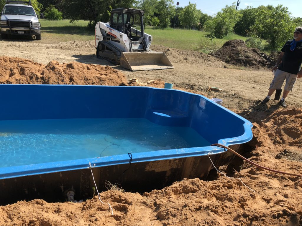 """We over dig our pool shell by 12""""-24"""". This leaves our crews plenty of room to get beneath the structure and plumb our return lines & lighting."""