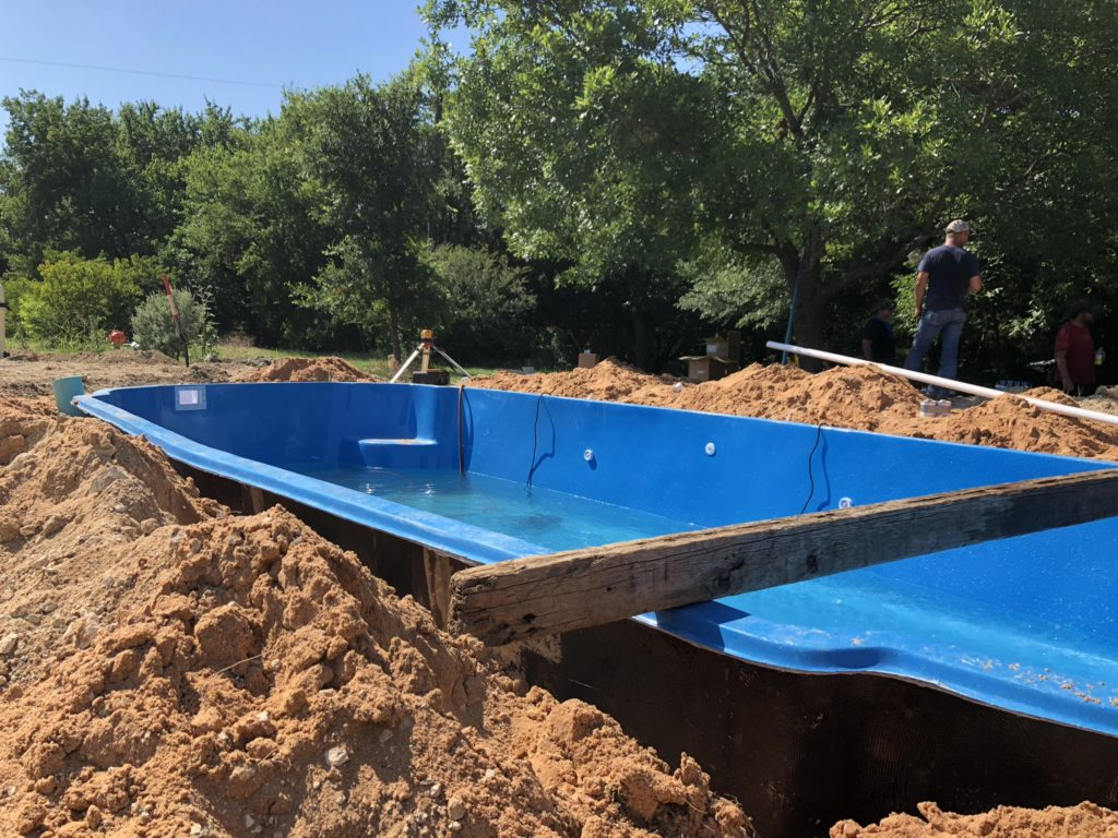 We are hard at work installing a new Hawaiian fiberglass pool in McKinney TX! This fiberglass shell was delivered with good timing! We are expecting our installation of this new fiberglass pool to complete the day before July 4th. Party time!