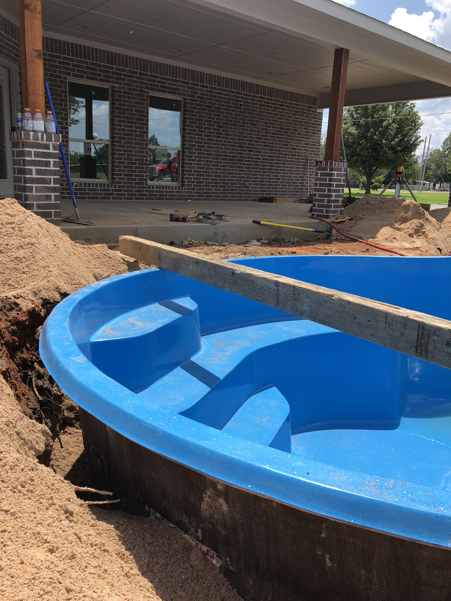 """As you can see from this image, we """"Over Dig"""" our swimming pool by about 6""""-12"""". This allows our crews to properly set, ensure our pool is level and install our plumbing and electrical - once the pool is lowered into our hole."""