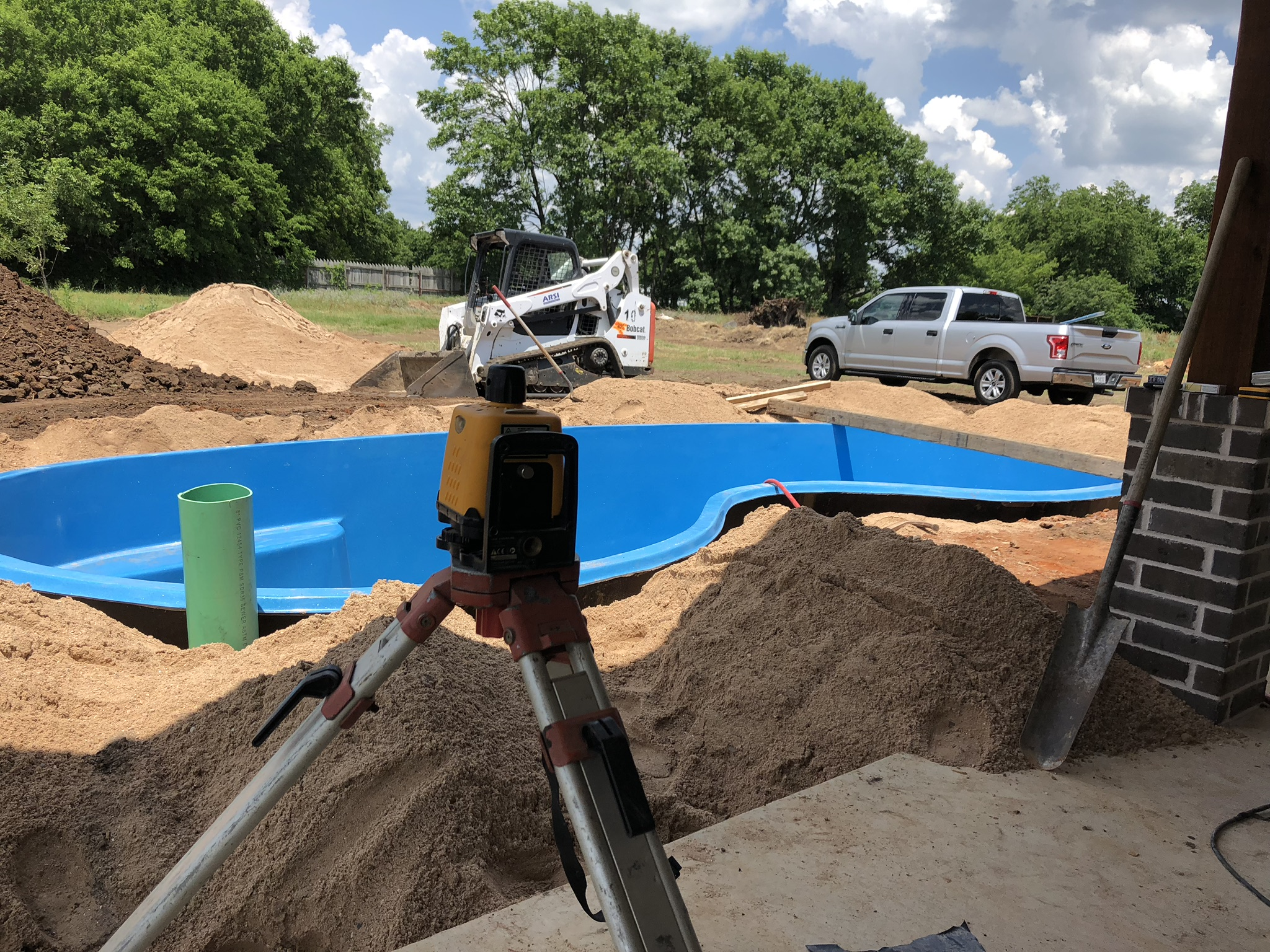 Believe it or not, we required only a two man installation crew for this new pool install! Some may think that is a few men too short, but if you know what you're doing that's just right! This image shows our elevation measuring tool. We use this to ensure your pool is set level. All of this work is completed before your pool arrives the same or second day after excavation.