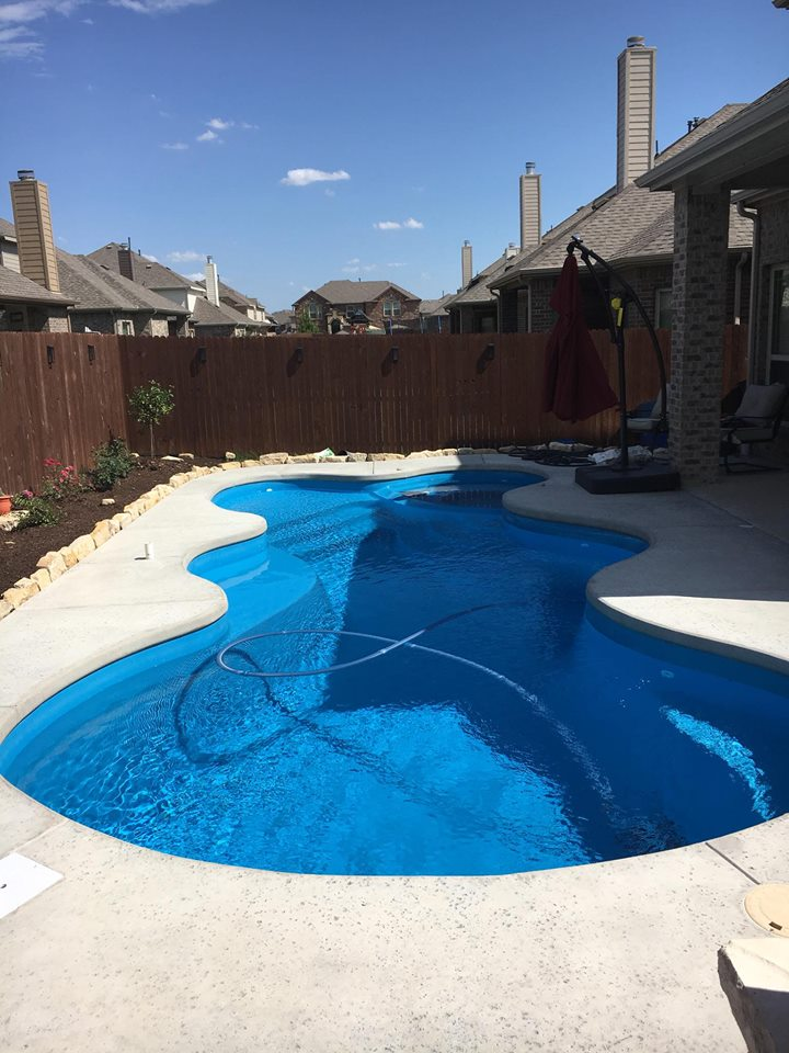 We are hard at it this week with the completion of another fiberglass swimming pool in University Park TX. We are finishing up at that job site presently, so we are taking a moment to cover a job recently completed: Fort Worth TX! This image shows a gorgeous Desert Springs fiberglass pool installed in June of 2018 in Fort Worth TX. We love the beautiful blue lagoon gel coat paired with the ivory cantilever deck.