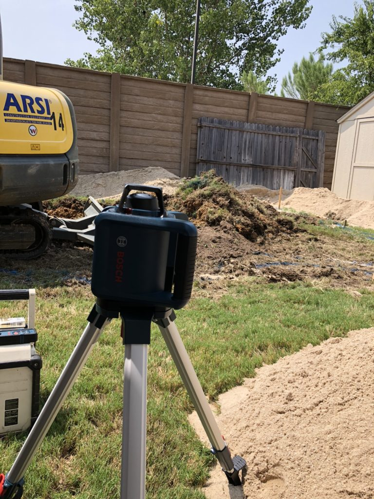 Prior to excavation, we use our Laser Level to capture elevation points and set visual stakes to help our crews operate. These stakes are placed at specific points along the border of our swimming pool and we use them again to ensure the pool is level after arrival.