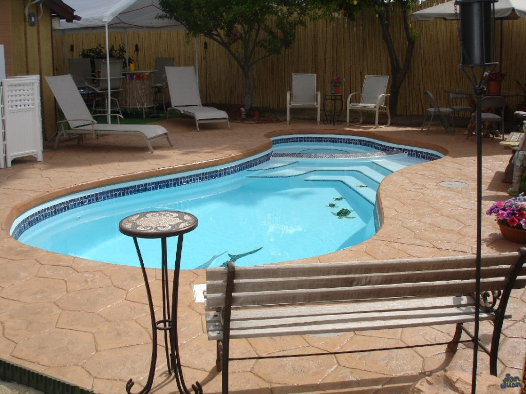 Welcome to the Mandalay fiberglass pool offered only by Fiberglass Pool Guyz! This is a beautiful free-form swimming pool paired with an attached spa. We love this swimming pool because of it's unique shape and design that offers a wide range of outdoor applications! We especially love it because of it's diverse pairing with various decking & outdoor accessories.