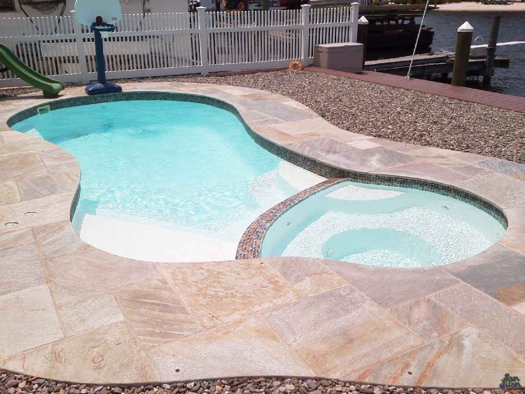 Here you can see the beautiful opacity of the pool water paired elegantly with the White gel coat offered by San Juan Pools! This creates a natural water tone that is both tropical and soothing for the soul!