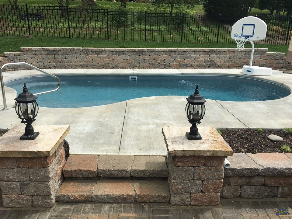 What a beautiful backyard escape! This Sandcastle looks like it's right at home in this attractive cantilever pool deck! Paired nicely with a set of entry steps and basketball set (for the kids), this swimming pool is ready for it's family to return home and enjoy some exciting times outdoors!