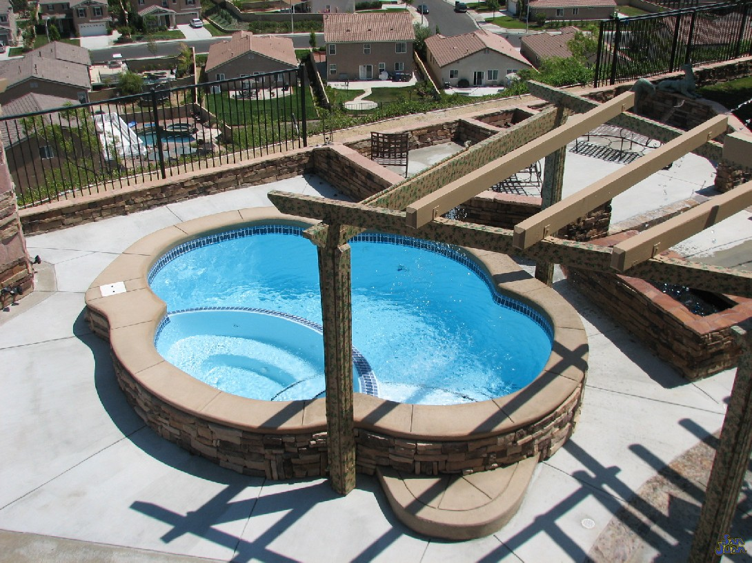 "This is a great example of the potential you have with the Crystal Springs. This client installed this pool on a raised beam. Rather than set it entirely in the ground, they raised it up about 12"" to create an easier way to enter and exit the swimming pool."
