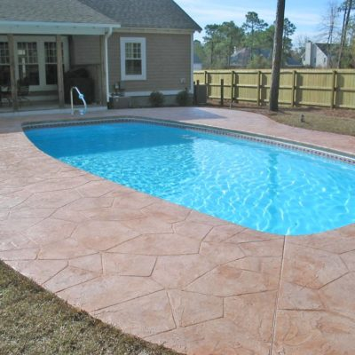 "The Majestic is a rectangular shaped fiberglass pool with curved sides. This majestic shell includes a full width set of shallow end steps and 5' 5"" deep end. It is very friendly for intermediate swimmers and fun for the whole family!"