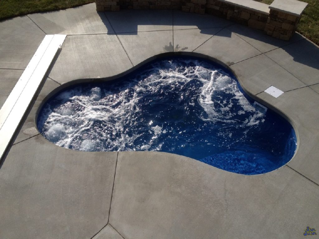 """The Montreal Spa is a quaint & compact fiberglass spa with a free form shape & flat bottom. With a depth of only 3' 9"""" - the Montreal is a comfortable spa for any user. We recommend the Montreal Spa as an add-on to any of our fiberglass swimming pools or as a single unit in a small backyard."""