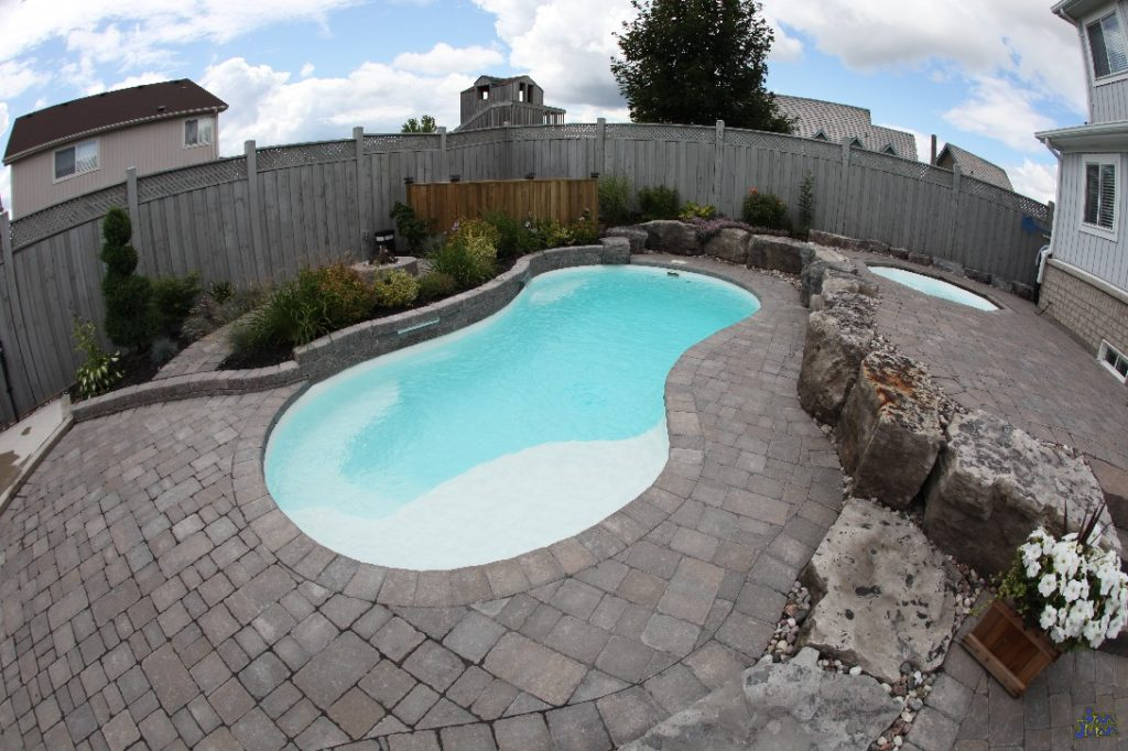 "The Sundial is a beautiful free form pool that slightly resembles a ""figure-8"" layout. This beautiful fiberglass pool  is both petite in size and perfect for our clients who consider themselves to be casual swimmers. You're sure to enjoy the very familiar standard hopper (deep end to one side), curved entry steps and tanning ledge of the Sundial!"