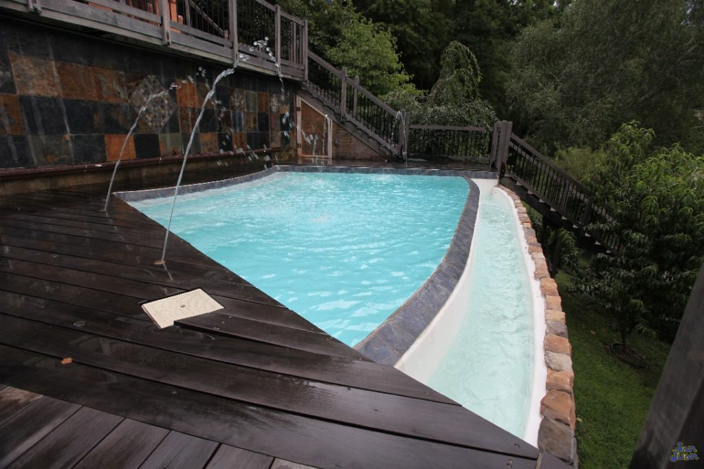 This image showcases the stunning Infinity Edge design of the Horizon fiberglass swimming pool. This home owner also paired this magnificent pool with some playful deck jets for added personality.