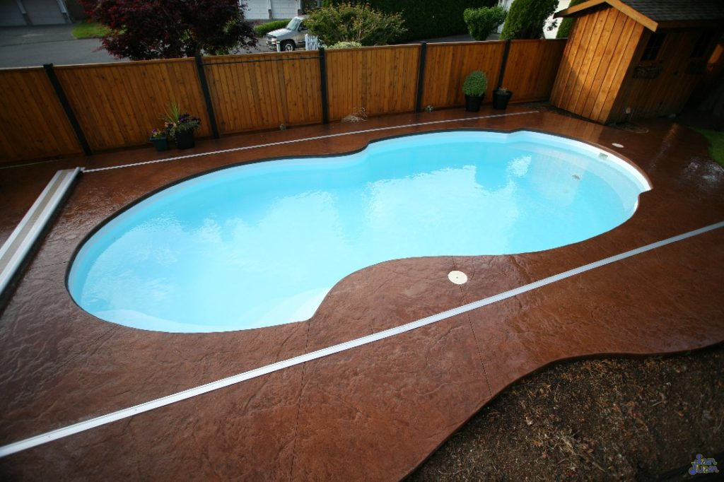 The Atlantic Deep is a robust fiberglass pool design. This unique shape takes the form of a funky figure-8 with curved walls and hidden benches. It's a swimming pool designed for hours of play and even provides an 8' Deep End for advanced swimmers!